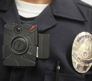 In this Jan. 15, 2014, file photo a Los Angeles Police officer wears an on-body camera during a demonstration in Los Angeles.