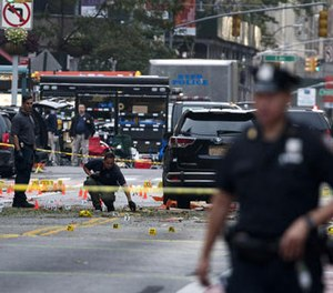 Crime scene investigators work Sunday, Sept. 18, 2016, at the scene of Saturday's explosion in Manhattan's Chelsea neighborhood, in New York. (AP Photo/Craig Ruttle)