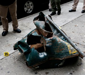 A view of a mangled construction toolbox, Sunday, Sept. 18, 2016, at the site of an explosion that occurred on Saturday night in the Chelsea neighborhood of New York. (Justin Lane/EPA via AP, Pool)