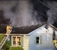 2 W.Va. firefighters rescued from structure fire