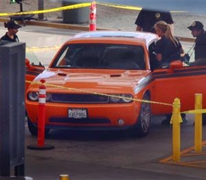 U.S. Customs and Border Protection investigators examine a car in the secondary inspection area at the San Ysidro, Calif., border crossing with Mexico, Tuesday, Aug. 12, 2014. (AP Image)