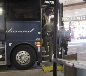Agents for Customs and Border Protection board a Greyhound bus headed for Portland, Ore., at the Spokane Intermodal Center, a terminal for buses and Amtrak, in Spokane, Wash. (Photo/AP)
