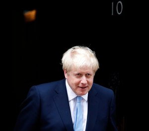 Britain's Prime Minister Boris Johnson leaves the door to welcome King Abdullah II of Jordan at 10 Downing Street in London, Wednesday, Aug. 7, 2019. Johnson holds bilateral talks and a working lunch with the King of Jordan. (AP Photo/Frank Augstein)