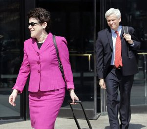 Defense attorneys Miriam Conrad, left, and David Bruck leave federal court in Boston, Monday, May 4, 2015. (AP Image)