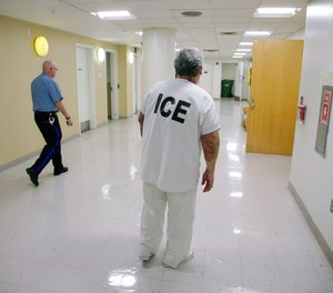 In this Sept. 1, 2017 file photo, Massachusetts Institute of Technology janitor Francisco Rodriguez-Guardado, facing deportation to El Salvador, returns to his cell during detainment by the department of Immigration and U.S. Customs Enforcement in the Suffolk County House of Correction in Boston.