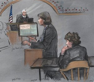 In this courtroom sketch, defense attorney Judy Clarke is depicted addressing the jury as defendant Dzhokhar Tsarnaev, right, sits during closing arguments.