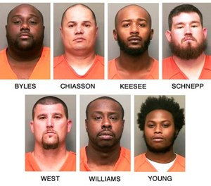 This combo of booking photos released by the Clarksville, Tenn., Police Department shows, top row from left, William L. Byles, Kenneth Chiasson, Antwon D. Keesee and Jonathan Schnepp; bottom row from left, Roger D. West, Prentice L. Williams and Joshua Young. (Clarksville Police Department via AP)