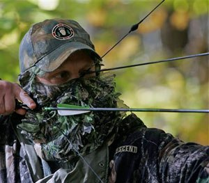 Jim Bruchac takes aim with compound bow and arrow as he demonstrates still hunting techniques used for hunting in Greenfield, N.Y.