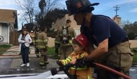 Video: Boy, 2, helps firefighters put out blaze