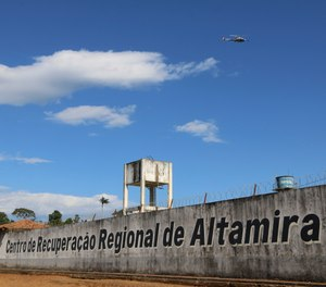 A police helicopter flies over the Regional Recovery Center, a prison, in Altamira, Para state, Brazil, Monday, July 29, 2019. (Wilson Soares/Panamazonica via AP)