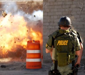 Members of the Roswell Police Department SWAT team perform explosive breaching training Thursday, Feb. 7, 2008. (AP Image)