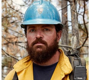 Capt. Brian Hughes was killed while he and his crew were removing hazardous standing dead trees to prevent the fire near Yosemite National Park from spreading.