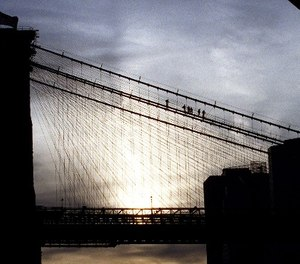 New York City Police Department Emergency Service personnel remove an attempted suicide victim from the Brooklyn Bridge, Wednesday, Nov. 25, 1998. (AP Photo/Steve Spak)