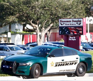 A Broward County Sheriff's Office vehicle is parked outside Marjory Stoneman Douglas High School, Wednesday, Aug. 15, 2018, in Parkland, Fla.
