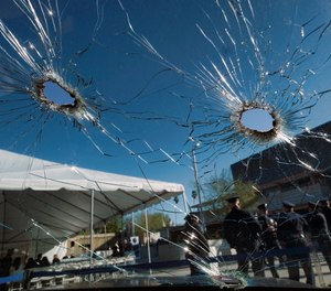 An inside view of a bullet ridden Los Angeles police department patrol car windshield is seen on display prior to a ceremony marking the 20th anniversary of an infamous gunbattle between police and two heavily armed bank robbers in Los Angeles on Tuesday, Feb. 28, 2017. (AP Photo/Richard Vogel)