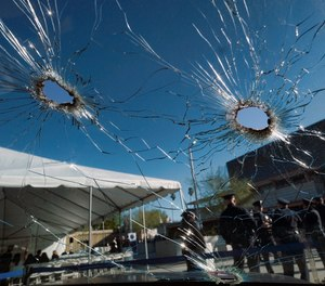 An inside view of a bullet ridden Los Angeles police department patrol car windshield is seen on display prior to a ceremony marking the 20th anniversary of an infamous gunbattle between police and two heavily armed bank robbers in Los Angeles on Tuesday, Feb. 28, 2017.