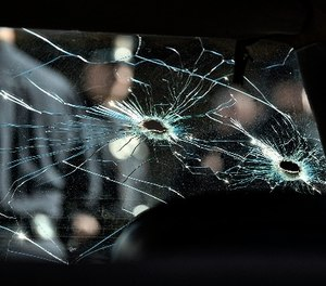 An inside view of a bullet ridden LAPD patrol car windshield is seen while on display at the North Hollywood police station prior to a ceremony marking the 20th anniversary of the shootout.
