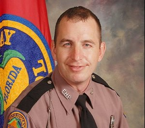 Florida Highway Patrol Trooper Joseph Bullock was killed Wednesday afternoon while 'assisting the public.' (Photo/FHP)
