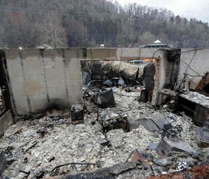 Some walls of a burned-out business remain after a wildfire swept through the area Monday. (AP Photo/Mark Humphrey)