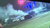 Good Samaritans save officer trapped in burning car
