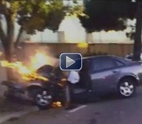 Video: Calif. cops save unconscious woman from vehicle blaze
