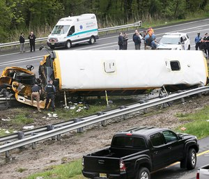 A school bus taking children on a field trip to a historic site collided with a dump truck on Thursday, ripping the bus apart and killing a student and a teacher. (Photo/AP)