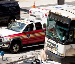 The windshield of a New Jersey Transit bus is cracked after an accident inside the Lincoln Tunnel, Wednesday, June 10, 2015 in New York. The bus rear-ended a private bus carrying Canadian schoolchildren inside the Lincoln Tunnel on Wednesday morning, injuring at least 18 people and slowing traffic on one of the busiest routes for commuters entering and leaving New York City, authorities said. None of the 26 students and two adults from the Toronto school was hurt, according to Anna Caputo, spokeswoman for the Toronto District School Board. (AP Photo/Mark Lennihan)