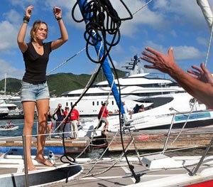 Dutch sailor Laura Dekker throws a rope as she docks her boat in Simpson Bay Marina in St. Maarten.