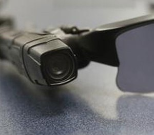 In this Jan. 15, 2014, file photo, a wired on-body police video camera is clipped to a Los Angeles Police officers glasses during a media demonstration in Los Angeles. (AP Photo/Damian Dovarganes, File)