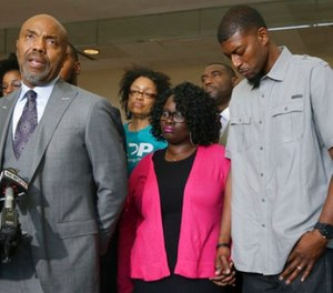 Attorney Daryl Washington, left, speaks on behalf of Jordan Edwards' parents, Charmaine Edwards, center and Odell Edwards during a news in Dallas, Thursday, May 11, 2017. (AP Photo/LM Otero)