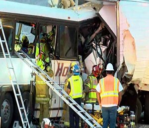 This photo shows the scene of crash between a tour bus and a semi-truck on Oct. 23, 2016. (KESQ NewsChannel 3/CBS Local 2 via AP)