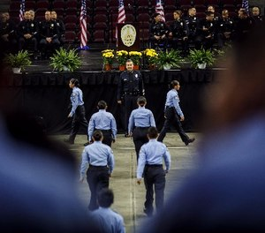 Los Angeles Police Department Chief Charlie Beck inspects the cadets before their graduation at the USC Galen Center in Los Angeles on Saturday, June 24, 2017.