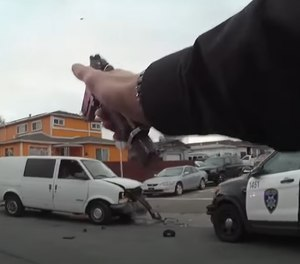 Body-worn camera footage shows an officer shooting through his cruiser's window to stop the suspect vehicle. (Photo/Screengrab of joint release video from Richmond Police Department/Oakland Police Department)