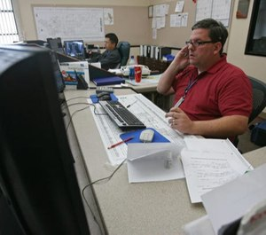 Dispatchers have started fielding 911 reports from concerned callers convinced a neighbor's overly loud sneeze or hacking cough is proof the person has the virus. (Photo/TNS)