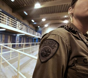This Aug. 17, 2011 file photo shows a correctional officer in one of the housing units at Pelican Bay State Prison near Crescent City, Calif.