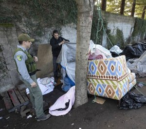 Sonoma County Park Ranger Darren Davis encourages homeless campers to finish packing their belongings as authorities cleared the Joe Rodota Trail homeless encampment in Santa Rosa. (Photo/TNS)