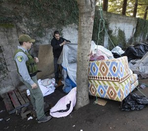 Sonoma County Park Ranger Darren Davis encourages homeless campers to finish packing their belongings as authorities cleared the Joe Rodota Trail homeless encampment in Santa Rosa.