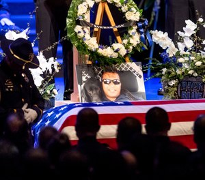 "In this Jan. 5, 2019, file photo, a picture of slain Newman Police Cpl. Ronil ""Ron"" Singh rests atop the casket during his funeral in Modesto, Calif. (AP Photo/Noah Berger, File)"