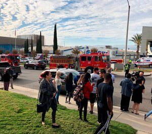 Student gather outside Saugus High School in Santa Clarita after a shooting that killed 2 students and wounded others. (Photo/AP)
