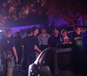 Multiple people were shot and at least four of them were killed Sunday at a party in Fresno when suspects broke into the backyard and fired into the crowd, police said. (Photo/Larry Valenzuela/The Fresno Bee/AP)