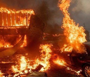 Police are investigating Camp fire cleanup workers who posted offensive photos of the aftermath of the deadly wildfire. (Photo/AP)