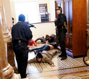 U.S. Capitol Police hold rioters at gun-point near the House Chamber inside the U.S. Capitol on Wednesday, Jan. 6, 2021, in Washington.
