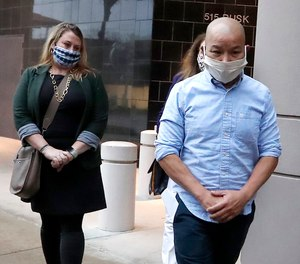 In this Jan. 21, 2021, photo former Houston Police Officer Tam Pham walks out of the Federal Courthouse downtown in Houston after he appeared in court following his arrest Wednesday on federal charges tied to Capitol violence. (Karen Warren/Houston Chronicle via AP)
