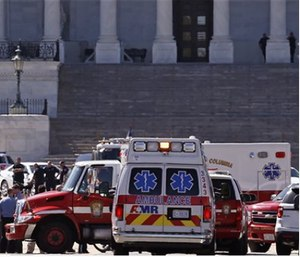 Law enforcement and rescue vehicles are seen on Capitol Hill in Washington, Monday after reports of gunfire at the Capitol Visitor Center complex.  (AP Photo/Alex Brandon)
