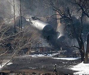 A crew member walks near the scene of a train derailment near Mount Carbon, W.Va. (AP Photo/Chris Tilley, File)