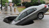 Photo: Ind. sinkhole swallows car carrying 4 people