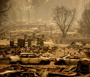 More than a dozen coroner search and recovery teams looked for human remains from a Northern California wildfire that killed at least 42.