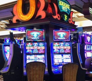 A new bill in Indiana could allow off-duty police officers to carry handguns into casinos. (Photo/TNS)