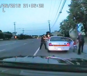 In this image made from July 6, 2016, video captured by a camera in the squad car of St. Anthony Police officer Jeronimo Yanez, the Minnesota police officer is shown after shooting into the vehicle at Philando Castile during a traffic stop in Falcon Heights, Minn.