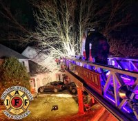 Photo of the Week: FFs rescue cat, owner from tree on Christmas Eve